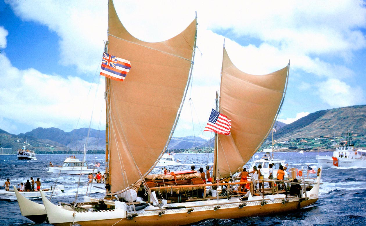 Hawaiian double hulled sailing canoe arriving in Honolulu from Tahiti