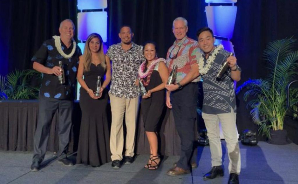 kauai coffee general manager fred cowell accepts a malama award from the kauai chapter of the Hawaii Tourism Association