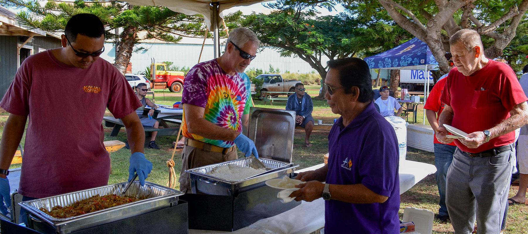 Kauai Coffee managers serve staff lunch at the Pau Harvest Celebration
